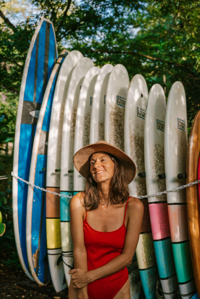 woman with surfboard behind her