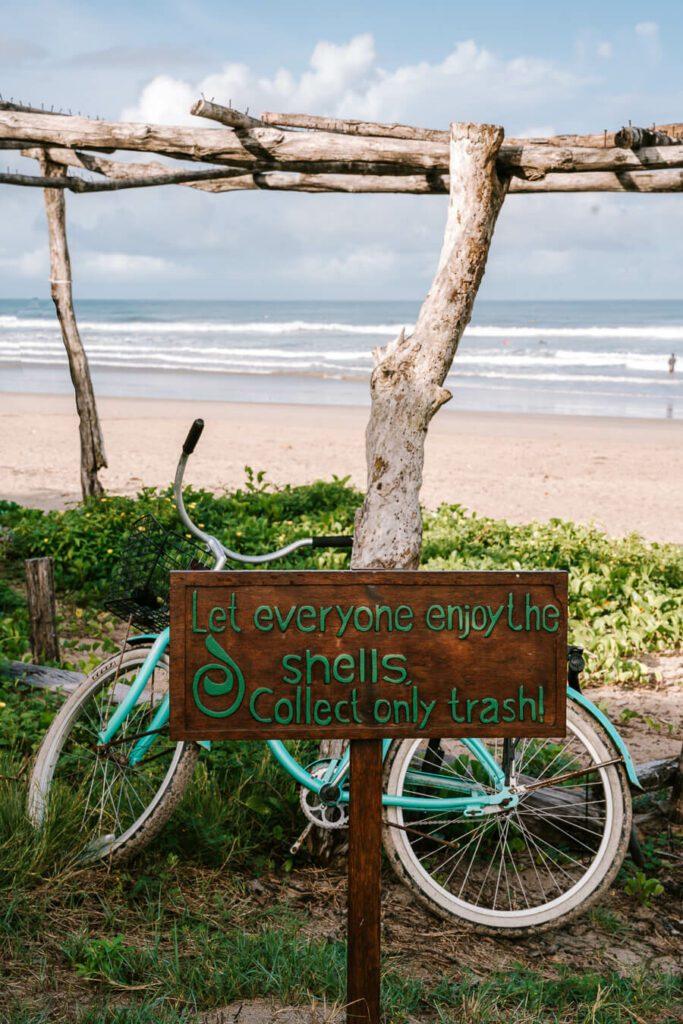 Sign and bike on the beach in Nosara Costa Rica