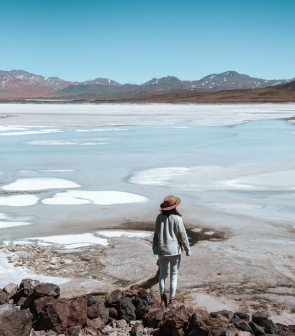 woman looking out at Salar de Talar in Atacama Desert